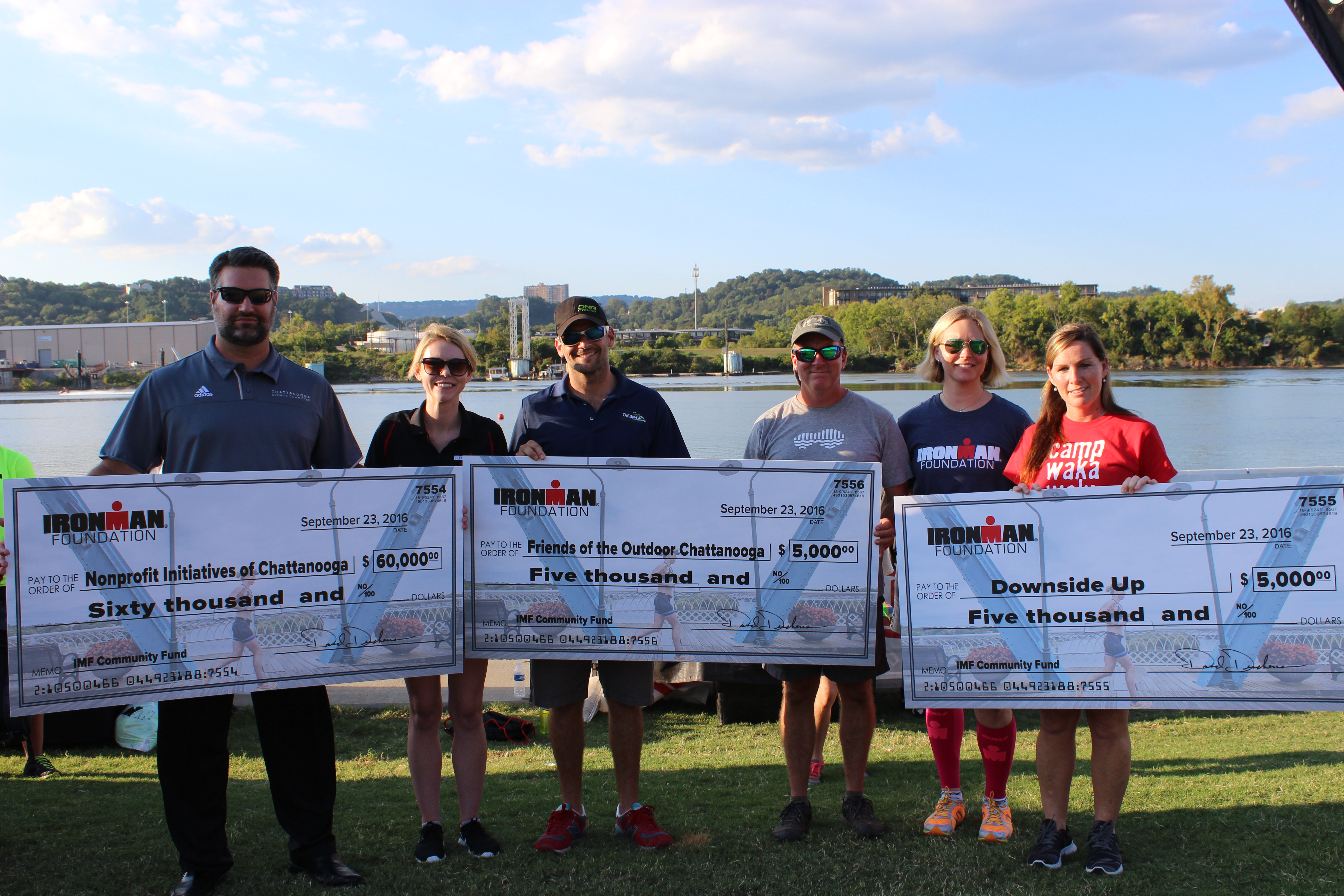 At the Athlete Welcome Ceremony, The IRONMAN Foundation presented checks to: Downside Up, Friends of The Outdoor Chattanooga, and various IRONMAN Chattanooga Volunteer Groups. TEAM IMF Athlete & IRONMAN Chattanooga Top Fundraiser, Erica Maynard-Uliasz, helped to present the grant awards!