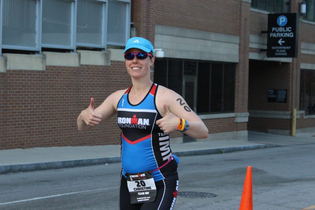 TEAM IMF Athlete, Christine Cooper, looking fresh at the beginning of the 26.2 mile run.
