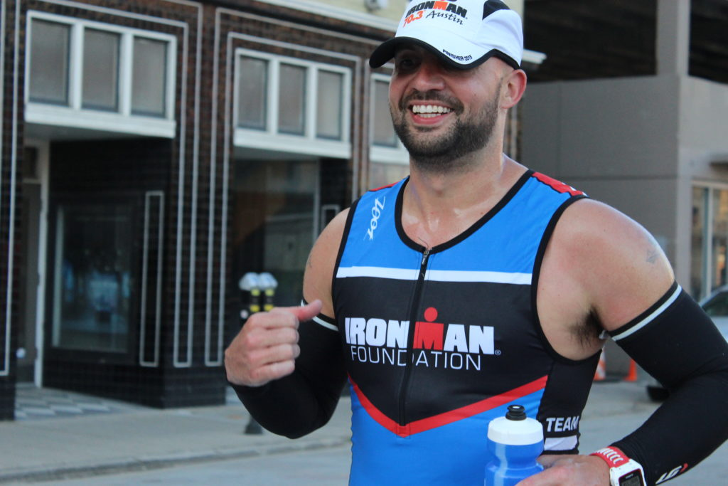 TEAM IMF Athlete, Jeremy McRae, flashes a smile as he passes by on the run course!