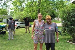 Professional Triathlete, Tine Deckers, with Ms. Angela. Tine was gracious enough to come spend some time and help out at the Service Project on Wednesday morning.