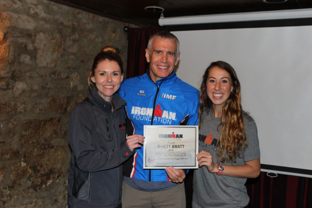 IMWI Top Fundraiser, Rhett Bratt, received a custom TEAM IMF Jacket, and a super sweet certificate for all of his incredible efforts! (Not pictured: Rhett also received an official IMWI Finisher's Jacket, 2 VIP Passes, and a $300 travel voucher)