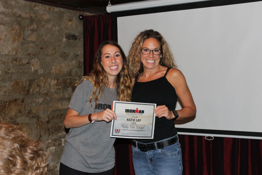 "IMWI TEAM IMF athlete, Katie Lay, received the ""Rally The Troops"" award, for all of her hard fundraising work, and ability to connect with friends and family to reach her goals."