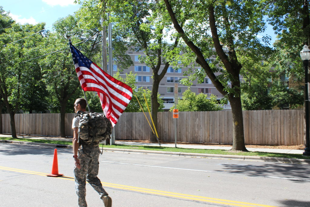 An inspiring athlete completes the IRONMAN Wisconsin run course in full military gear, to honor his fellow soldiers that lost their lives 15 years ago.