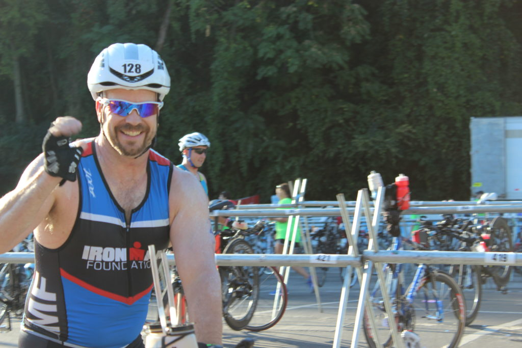 TEAM IMF Athlete, Nelson Robinson, is all smiles before the 114 mile bike ride- he had a great swim.