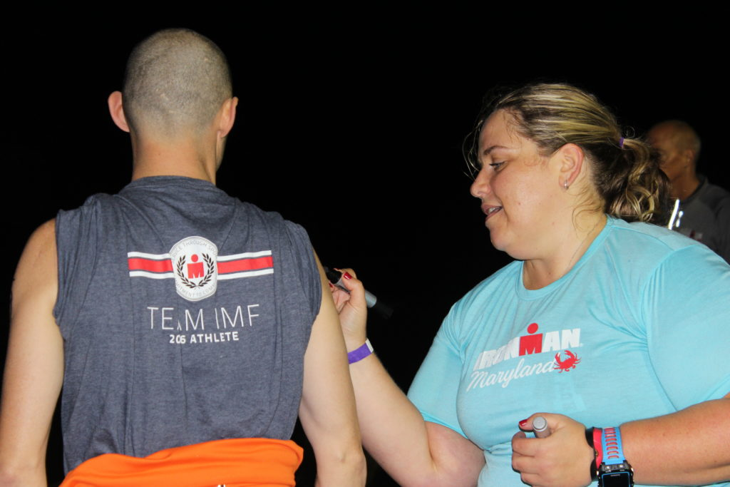 TEAM IMF Athlete Robert Hicks gets body marked in transition. He's ready to tackle his IRONMAN race!