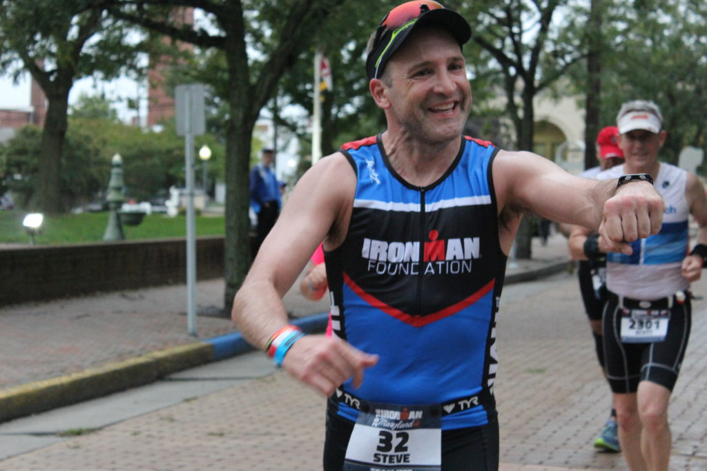 TEAM IMF Athlete, Steve Boyce, gives out free high fives on his 26.2 mile run.