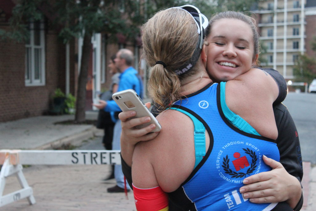 TEAM IMF Athlete, Tara Daley, gets a hug from her daughter Camryn to give her a boost on a tough day.