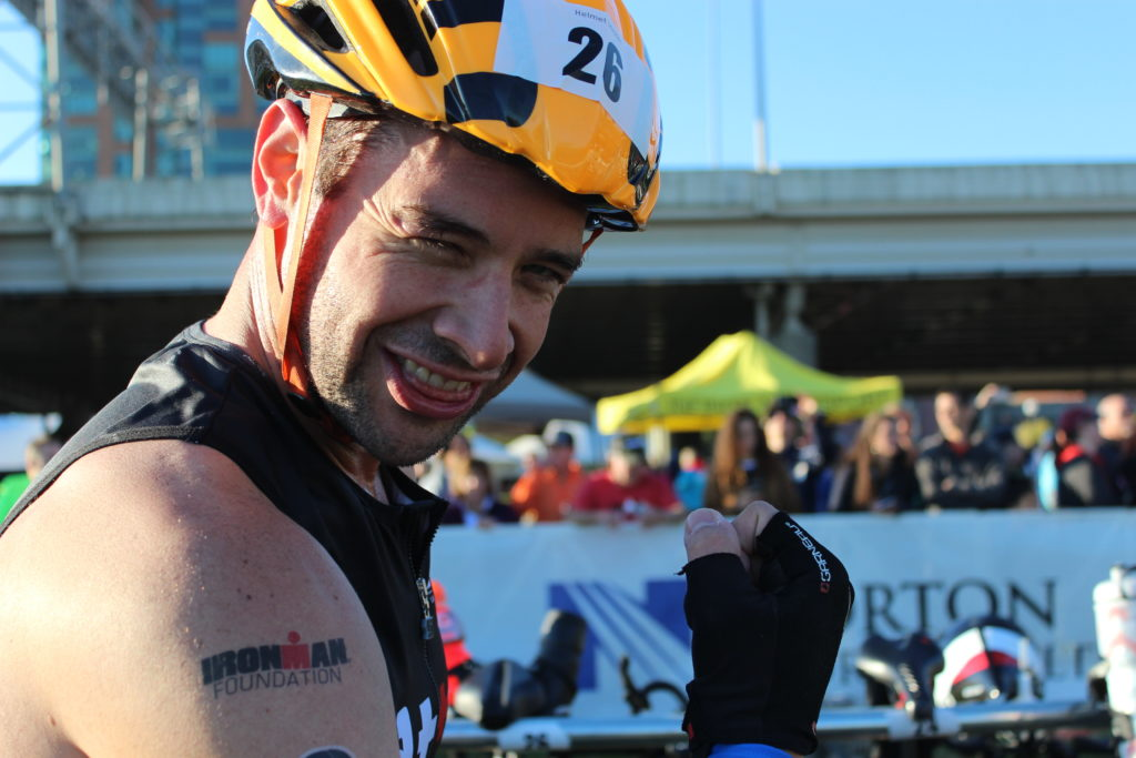 TEAM IMF Athlete, Pete Wenger, shows off his guns (and his IMF tattoo) in T1.