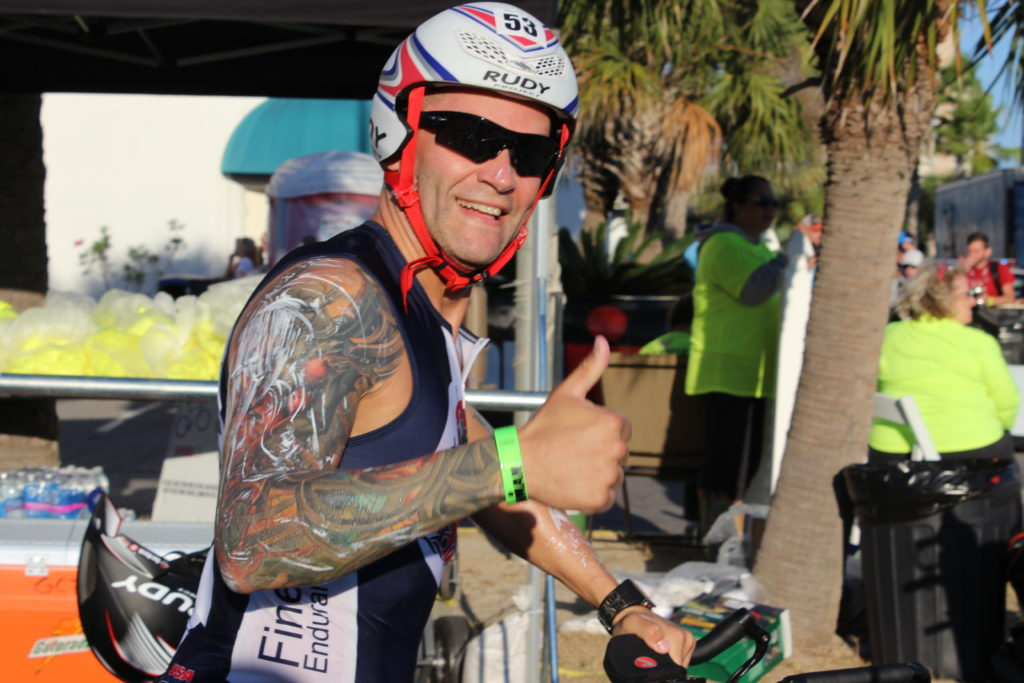 IRONMAN First-timer, and TEAM IMF Athlete, Tim Stamm, is pumped to see all of his hard training transfer into an awesome race day!