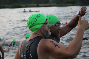 Two amazing and inspiring athletes, Leo Bourgeois & Marcus Cook, share a special moment at the swim start.