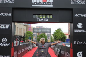 Our Service Project Beneficiary, Ms. Angela, at the IRONMAN Texas Finish Line.
