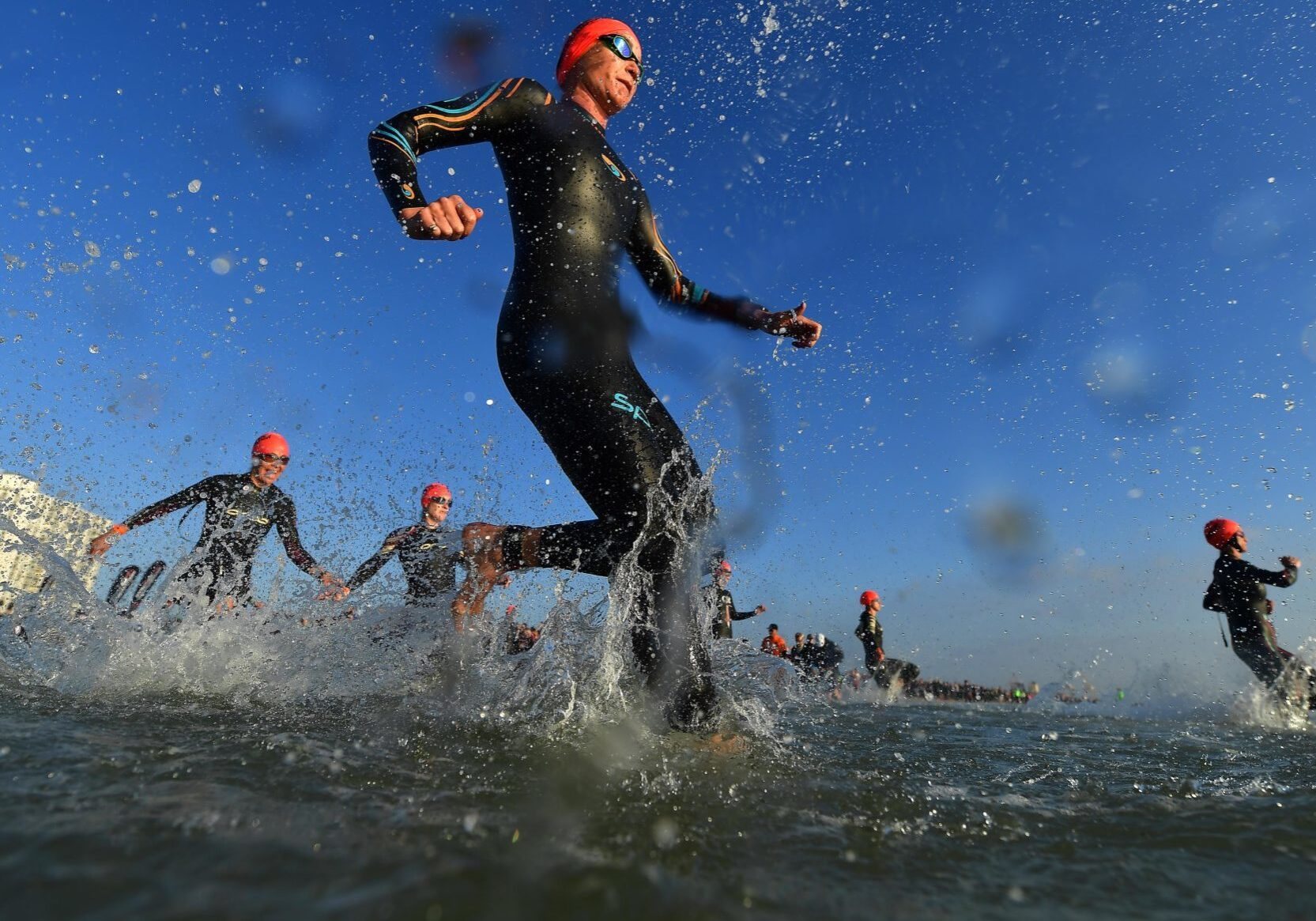 PORT ELIZABETH - SEPTEMBER 1:  General view of Age Group Athletes entering the water for the swim start during the Isuzu IRONMAN 70.3 World Championship Women in Port Elizabeth, South Africa on September 1, 2018. Over 4,500 athletes from over 100 countries will be represented in this years 70.3 World Championship. (Photo by Donald Miralle/Getty Images for IRONMAN).